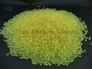 Low temperature particle packing adhesive